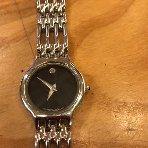 Movado women's stainless steel watch. New Battery